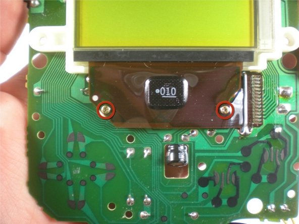 You're now going to turn the contrast ( the slider on the left) all the way up, and take your soldering iron and gently move it back and forth on the ribbon cable below the screen.