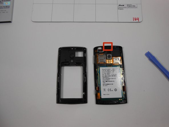 Once the clips are undone the back casing should dislocate and reveal the internal components of the phone. Audio jack location is identified on the image.
