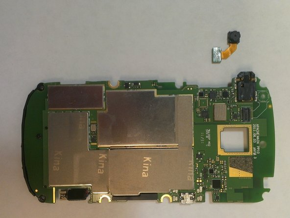 Flip the motherboard over to the back, this is where the front facing camera is located.
