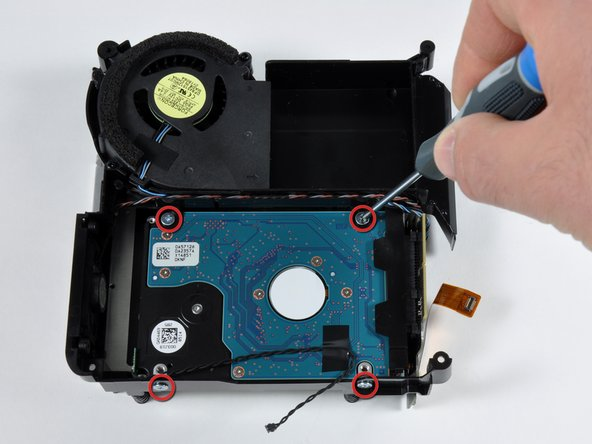Image 3/3: The hard drive easily slides out once it is detached from the interconnect board.