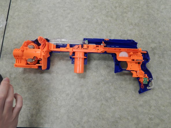 Image 3/3: Completely remove the left shell from the rest of the Nerf Gun.