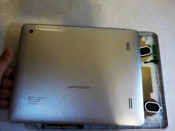 Image 3/3: Once the back is loose, remove it from the device and set aside.