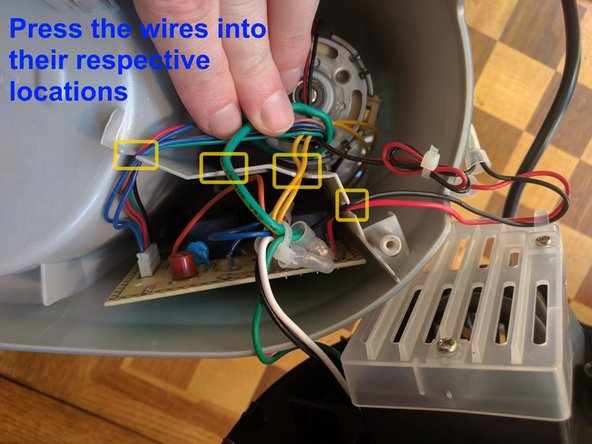 Guide the colored wire groups into their respective slots as shown by the third photo.