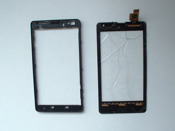 Image 2/3: Install the new touch screen and start to reassemble the device.