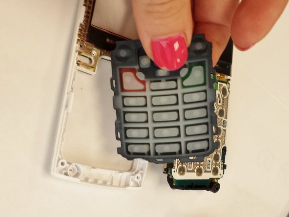 Replace the keypad with a new keypad and reverse steps to put the phone back together.