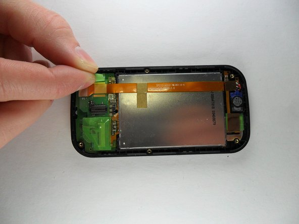 The next step is peeling off the three pieces of tape. The first two are green and located at the bottom left and bottom right of the phone. Carefully peel them off of the phone.
