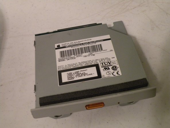 Image 1/3: Then remove the board. This will reveal that it is a standard PATA drive.