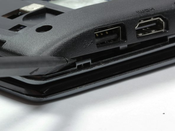 Unclip the bottom half of the case from the laptop by using a spudger and starting at the USB port on the right side of the laptop. Then work your way clockwise around the laptop.