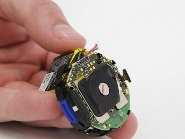 Remove battery from plastic housing.