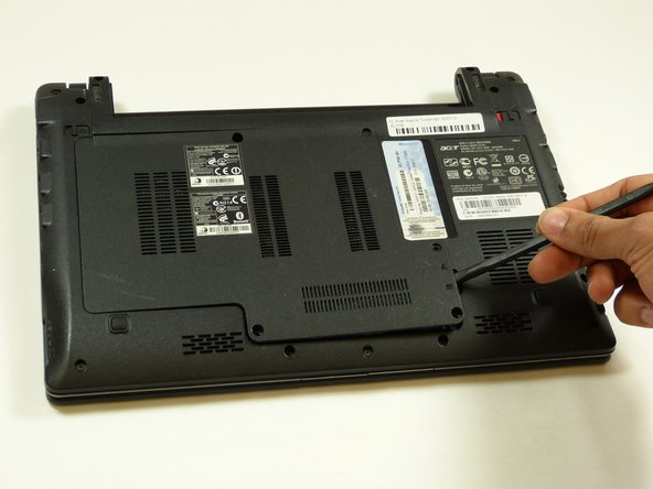 Pry open hard drive cover using the Spudger tool.