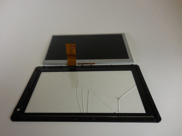 Remove the grey monitor from the glass screen cover by gently lifting it up.