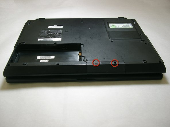 Remove the two screws securing the hard drive access cover.