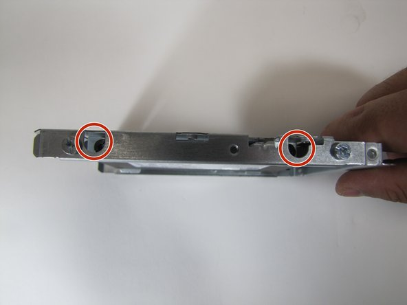 Image 1/1: Notice that the screws to remove are the four screws inside the holes rather than the screws that are next to the holes.