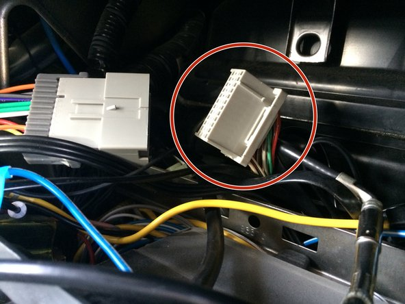 """To remove the group of wires"", follow the wires until you reach a connector and unplug the connector."