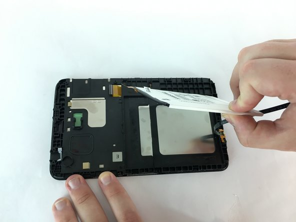 Using the plastic opening tool, put it between one of the corners of the battery and the edge and gently pry it out