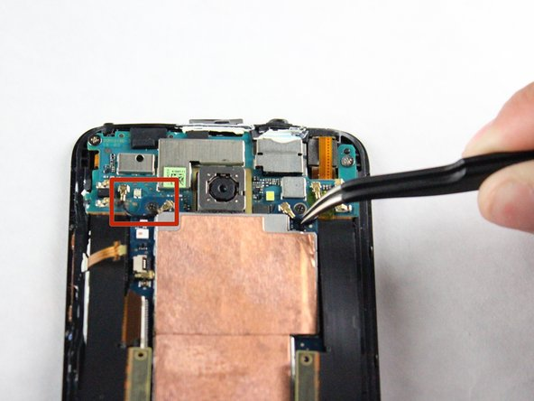 Reorient the phone so that the green camera board is farthest from you.