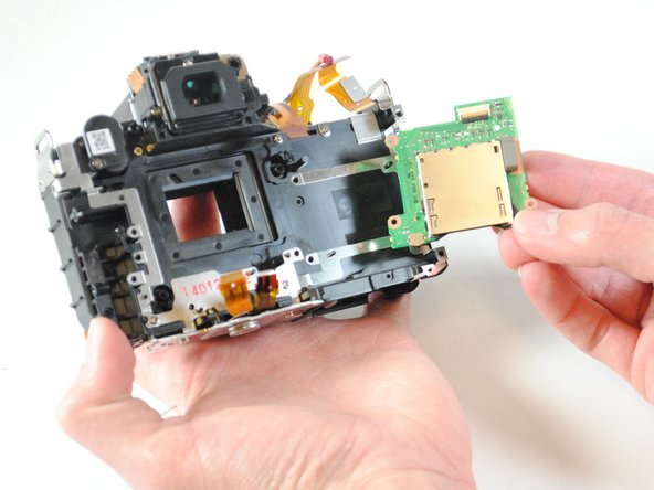 Using your fingers, remove the SD card reader from the back of the device.