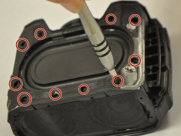 Image 1/1: Using a 0mm Philips Head screwdriver, unscrew the 10 0.6mm screws located around the outside of the woofer.