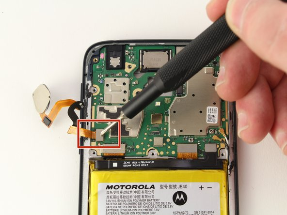 Using the iFixit opening tool, carefully disconnect the ribbon cable connecting the fingerprint scanner to the motherboard.