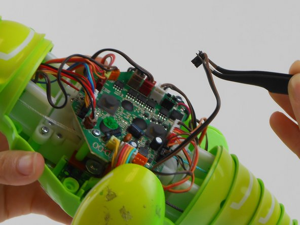 Use tweezers to remove all of the colored wire connectors from their sockets on the circuit board.