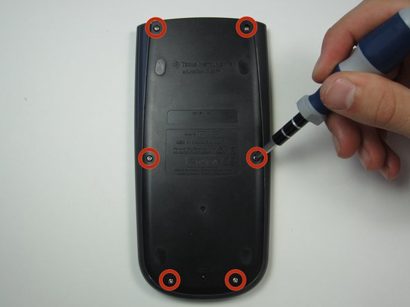 Using a Phillips #1 screwdriver, remove the six 6mm screws from the back of the case and place them to the side.