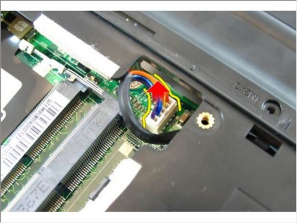 Disconnect the DC-in cable connector from the system board.