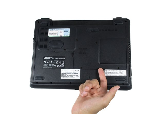 Image 1/3: Gently lift the upwards, and the back panel of the laptop will come off easily.
