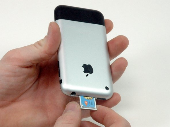 Image 1/1: Grasp the SIM card tray and slide it out of the iPhone.