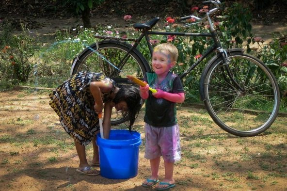 David Kraemer's son having a waterfight in India