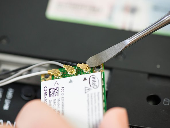 Use a spudger to carefully disconnect the antenna cables from the card by prying them straight up off the board.