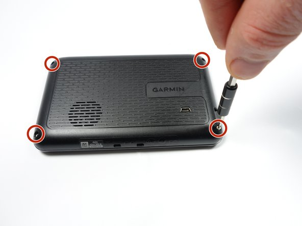 Remove the four 9 mm  screws on the back of the GPS with the T4 Torx screwdriver.