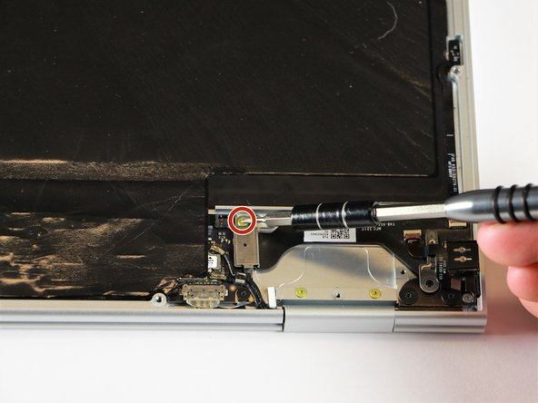 Remove the yellow 2.0mm screw by using the T3 Torx screwdriver to turn the screw counterclockwise.
