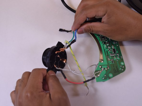 From the circuit board, there are two white wires and one red wire to be disconnected.