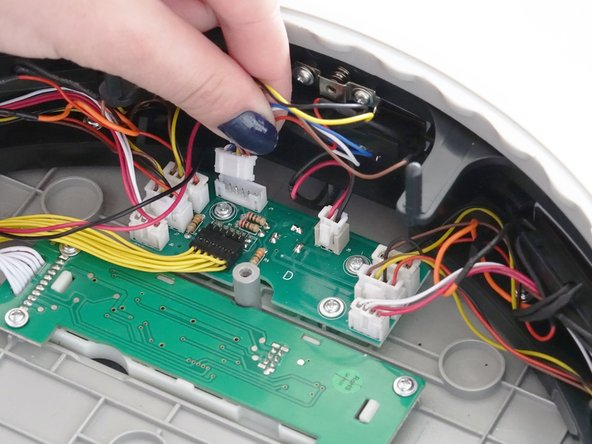 Image 2/3: If there is any glue holding down the other wires, you may scrape it off using a tool such as a screwdriver.