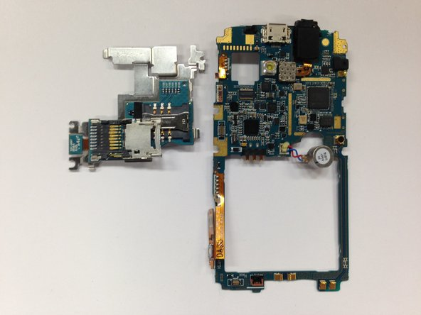 Image 2/2: This is the only attachment that is holding the daughterboard to the motherboard. You can no remove the daughterboard.