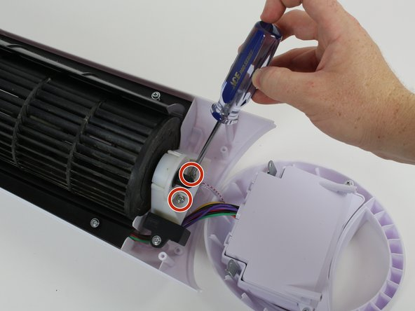 Image 1/3: Slide the plastic fan cap off the fan while holding the fan blade to ensure it comes off smoothly.
