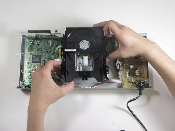 Lift disc drive vertically to remove.