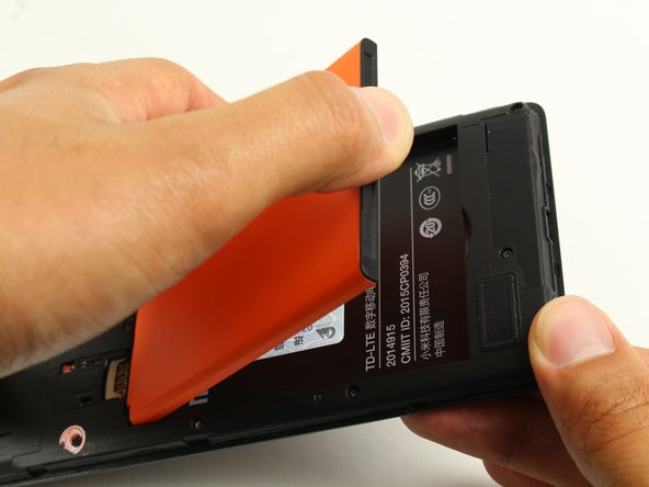 Place a finger in the indentation and lift up to remove the battery.