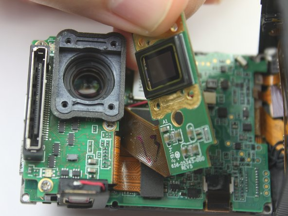 To remove the sensor assembly, simply peel  off the lens towards the attached ribbon cable.