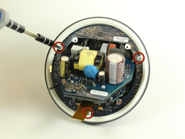 Once you remove the ball bearing ring from the bottom half of the Nexus Q, you will be exposed to a diffuser (white ring) held in with three T6 Torx screws.