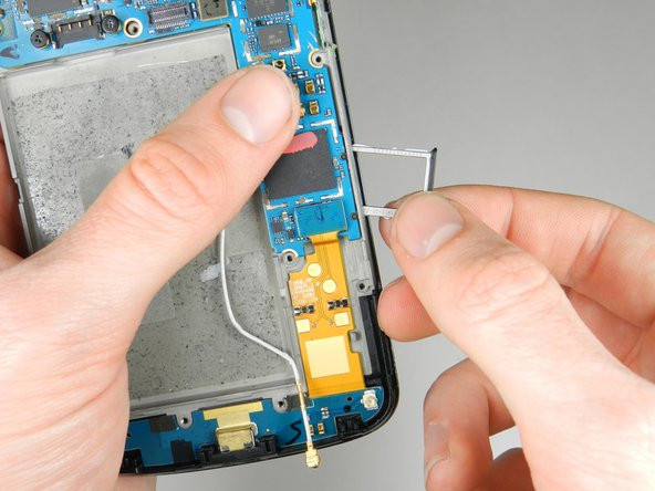 Remove the Sim Card and the Sim Card metal tray.
