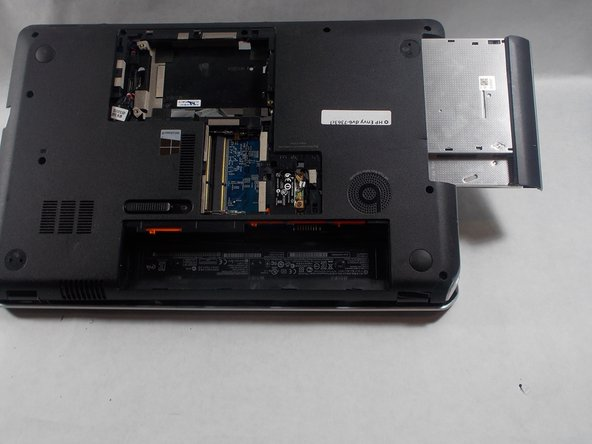 Flip device onto its back,  remove disk tray and circled screw.