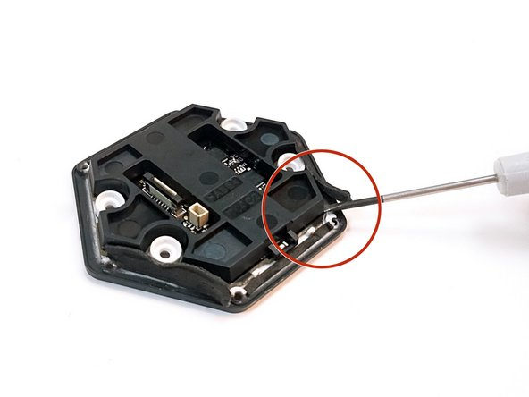 Image 1/3: Lift up the plastic casing with a flat-head screwdriver.