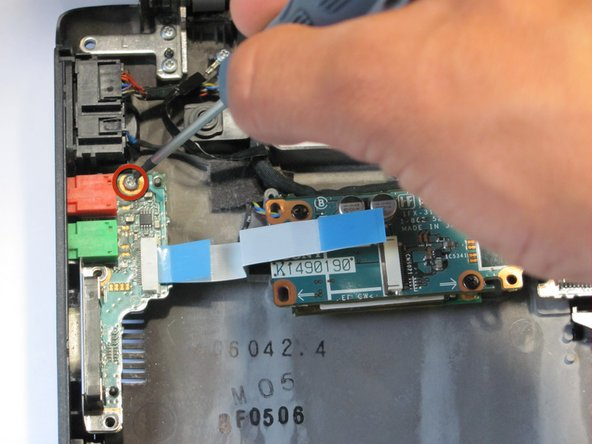 Locate the screws for the second ethernet circuit board