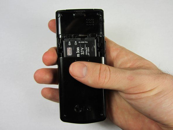 Use your thumb to press down and slide off the back cover of the phone.
