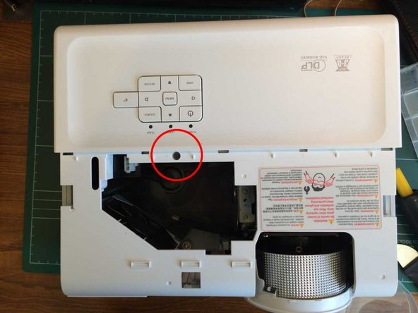 Remove a screw from just in front of the control buttons.