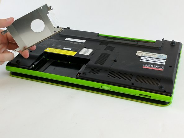 Remove the metal tray and the hard drive which is attached to it.