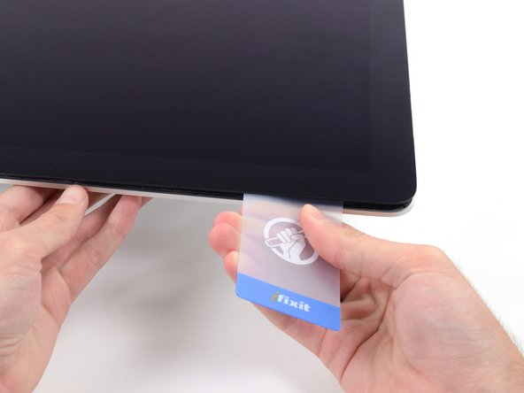 As with the other side, move slowly to allow the adhesive to break, and be careful not to over-stress the display glass.