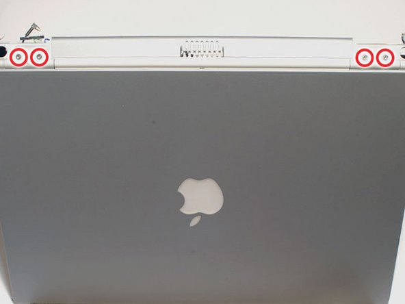 Position the display at a 45 degree angle and rest the computer on a soft cloth with the back panel ports facing up.
