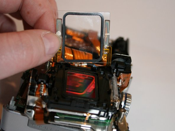 Remove the sensor lens by pulling back as shown.